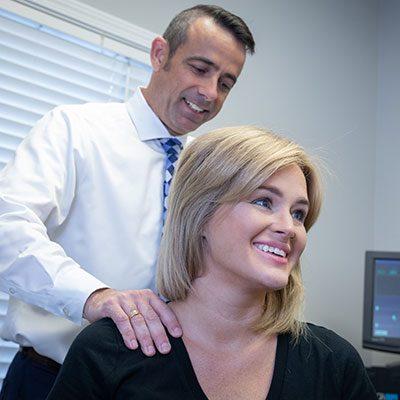 Chiropractor Mauldin SC Matthew Eiken with Happy Patient